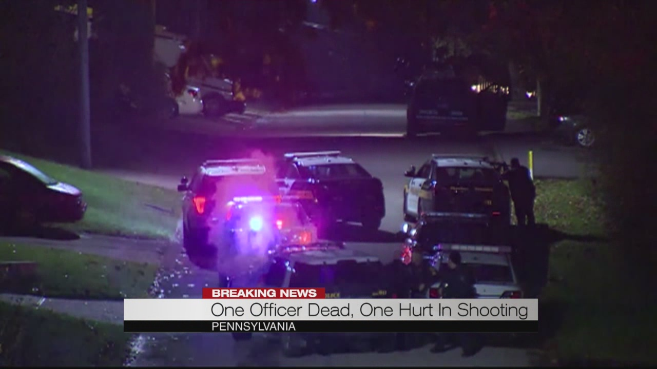One officer dead, one hurt in shooting