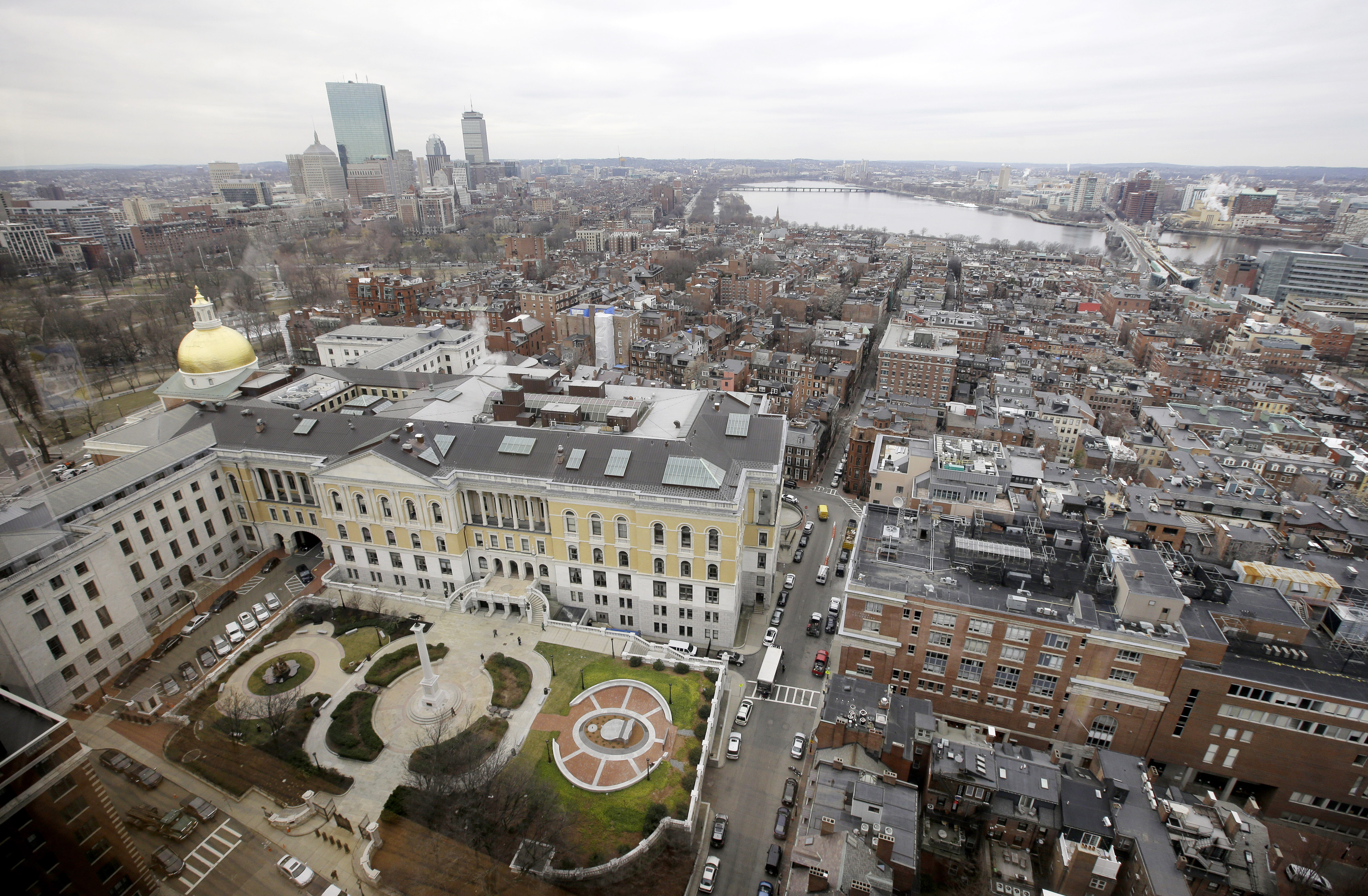 In this Tuesday, Jan. 31, 2017 photo a portion of the Boston Skyline is seen through a window from the office of Massachusetts Attorney General MauraHealey, in Boston. (AP Photo/Steven Senne)