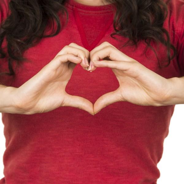 shutter stock go red for women american heart association heart health female woman wearing red shirt love_259393