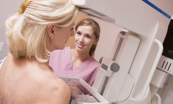 Nurse Assisting Patient Undergoing Mammogram_319858