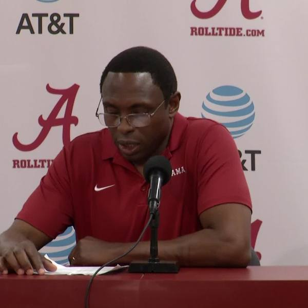 COACH AVERY JOHNSON AND PLAYERS