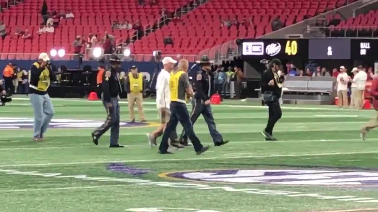 Alabama head coach Nick Saban walks on the field before the SEC Championship 2018