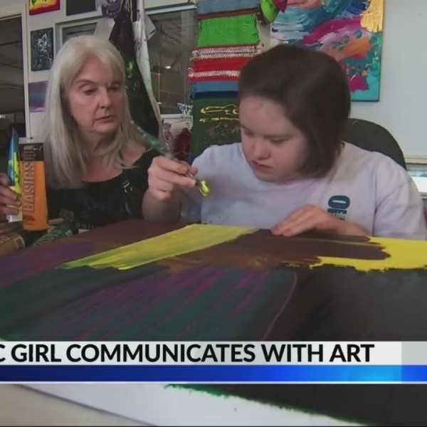 Austic girl communicates with art