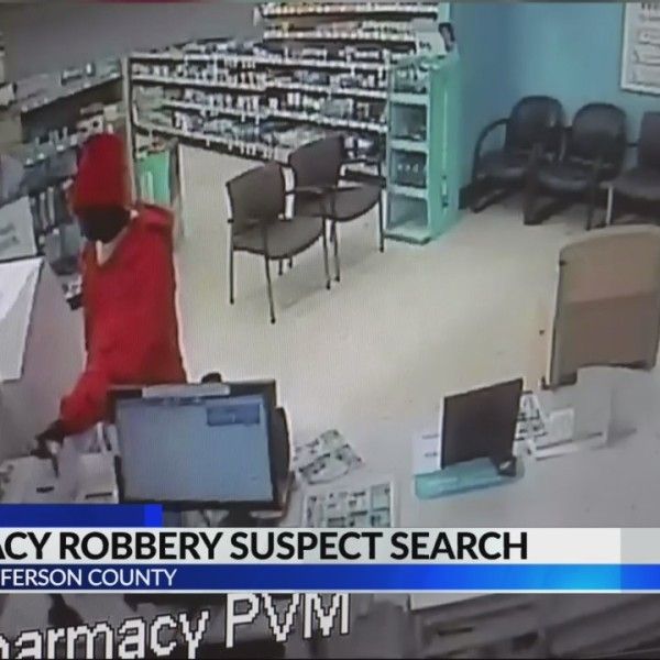Police search for pharmacy robbery suspect