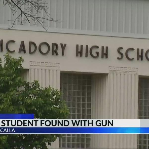 Former student found on school campus with gun