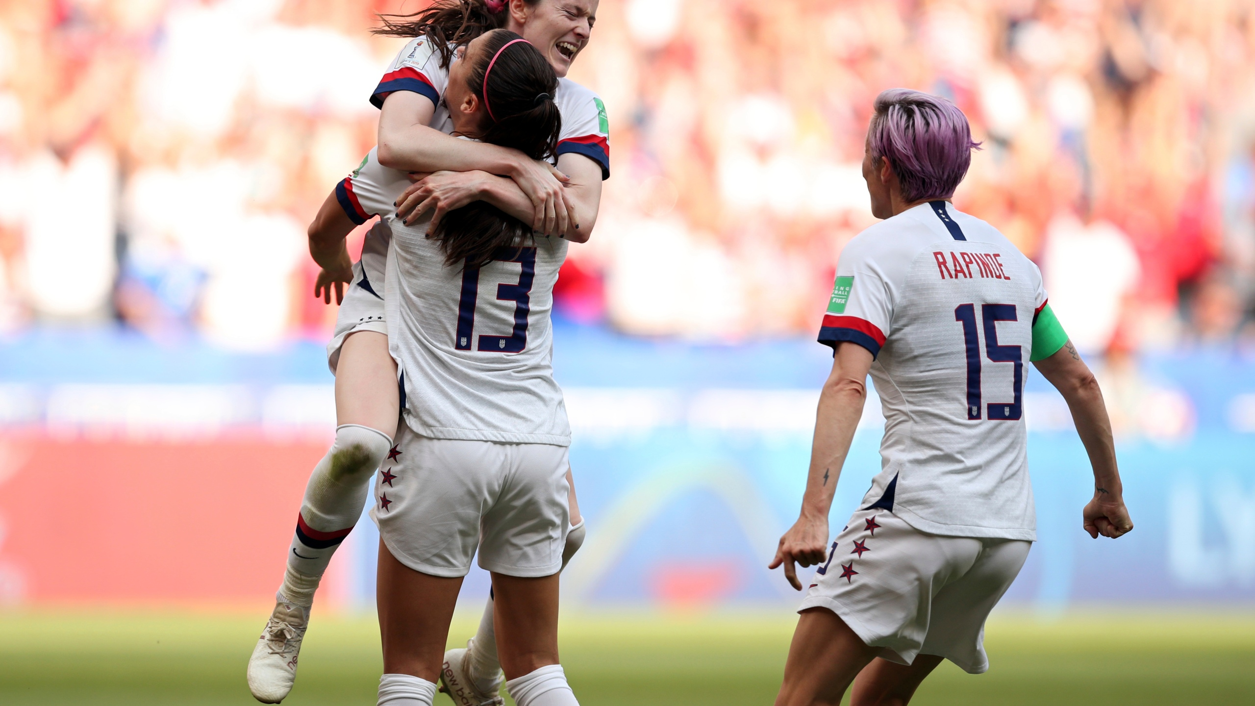 62baaff5c2c760 United States' Rose Lavelle, top, celebrates with Alex Morgan and Megan  Rapinoe, right, after scoring her side's second goal during the Women's  World Cup ...