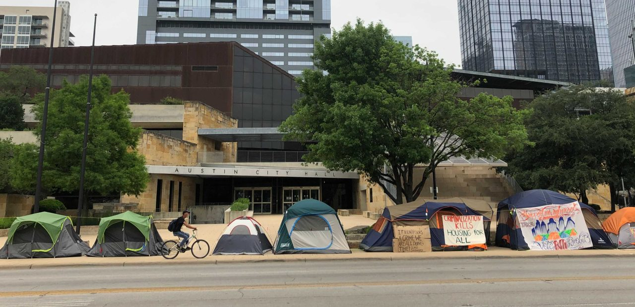 Austin City Hall surrounded by tents during camp-in protest of new public camping ban