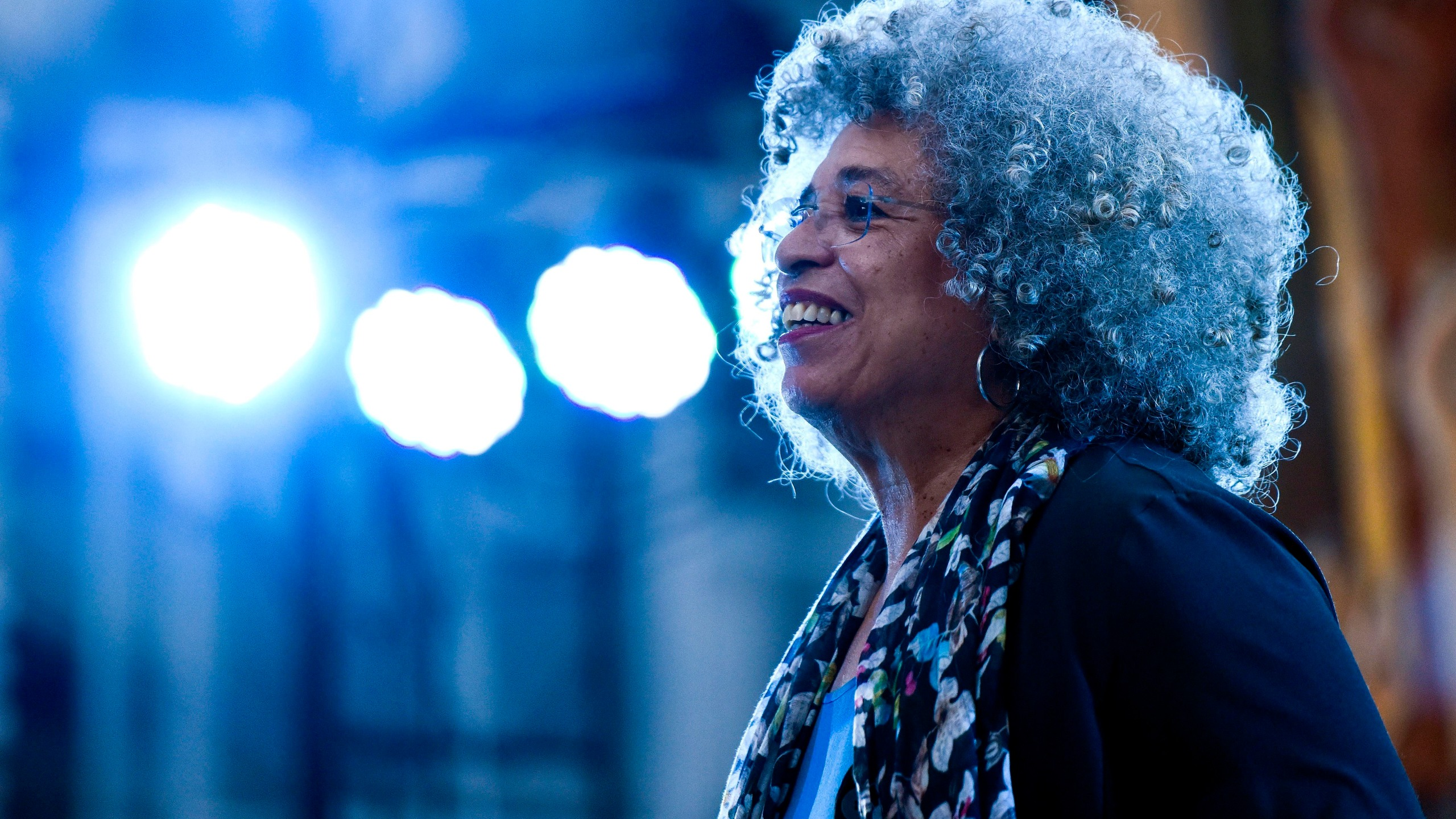 American political activist Angela Davis appears on the stage before speaking during an open air rally in front of the University of the Republic, in Montevideo, Uruguay, Saturday, March 23, 2019. Davis received a Honoris Causa Doctorate degree from the Uruguayan university. (AP Photo/Matilde Campodonico)